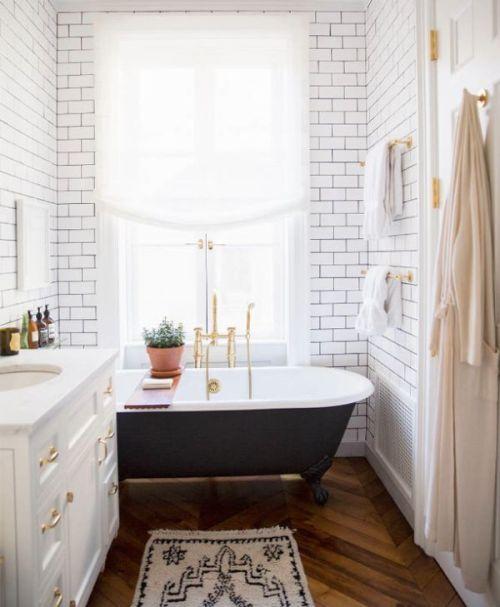 Ali-Cayne-NYC-townhouse-home-Greenwich-Village-bathroom-bath-tub-black-gold